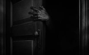 Hånden på dørklinken